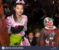 teen in polka dot dress and boy in a halloween evil scary