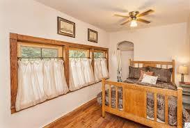 cottage guest bedroom with hardwood floors flush light in duluth