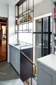 floating bar above kitchen sink on industrial shelfceiling hung