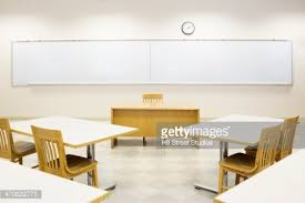 Lecture Hall Desk Tables And Blackboard In Empty Lecture Hall Stock Photo Getty Images