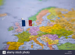 Dijon France Map by Flag Pin Placed On World Map In The Capital Of France Paris Stock