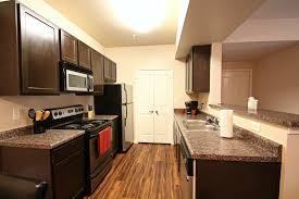 light brown kitchen cabinets with black appliances kitchen a t corporate housing
