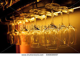 glasses wine glasses hanging above bar stock photo 740978134
