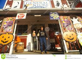 man on porch of country store in williamstown vt covered with