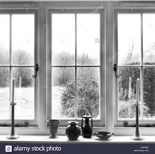 white window frame with window sill with 2 candles and glass stock