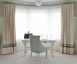 desk bay window home office transitional with striped curtains
