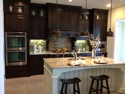 White Knotty Alder Cabinets Knotty Alder Cabinets Paired With An Antiqued White Maple Island
