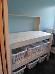 laundry divider hamper i made this laundry sorter based upon a potting bench diy plan i