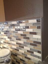 how to tile a kitchen backsplash contemporary kitchen brown glass tile kitchen utensils spoon