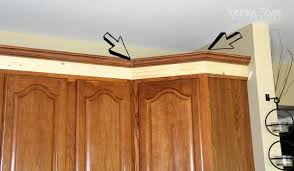 adding crown molding to cutting crown molding on kitchen cabinets marvelous adding crown