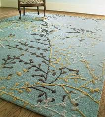 fusion coral fixation area rug in sea green blue and white for
