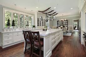 matching white kitchen cabinet sets and natural wood flooring with
