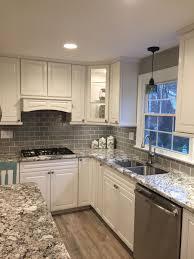 antique white kitchen cabinets with subway tile backsplash stunning remodeled kitchen using gray glass subway tile