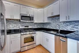 white cabinets with black countertops and backsplash white kitchen cabinets with black countertops walls and