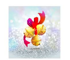 glossy golden jingle bells with ribbon on silver glitter