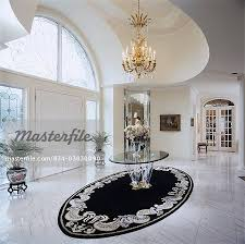 black entry hall table entry halls marble floor double door chandalier white large