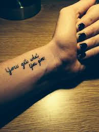 wrist tattoo cute tattoo quote tattoo you get what you give tattoo