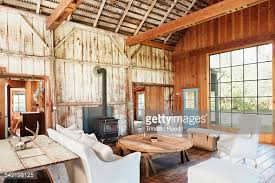 farmhouse livingroom sofas coffee table and rustic walls in farmhouse living room stock