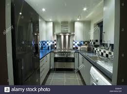 small modern kitchen a small modern domestic kitchen with a fridge freezer washing
