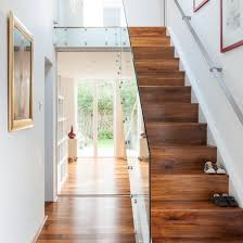 white hallway with walnut and glass staircase white hallway