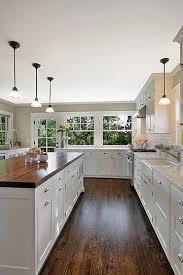 white kitchen wood floors white cabinets dark hardwood floors butcher block island