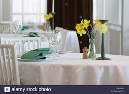 a restaurant table with a white linen table cloth set for two