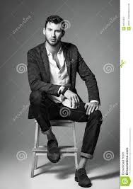 studio fashion shot portrait of handsome young man in jeans