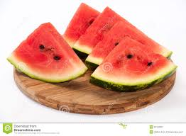 a beautiful arrangement of pieces of watermelon on a wooden boar
