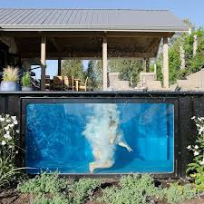pictures of swimming pools a swimming pool made from a shipping container this house has one