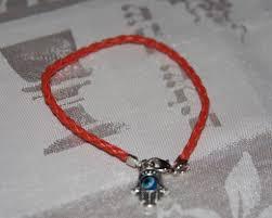 red bracelet with eye images Red bracelet jpg