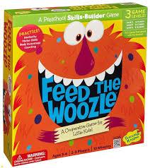 amazon com peaceable kingdom feed the woozle award winning