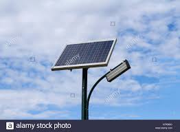 Solar Panel For Street Light by Public City Light With Solar Panel Powered On Blue Sky With Clouds