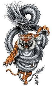 chinese dragon caught tiger tattoo design