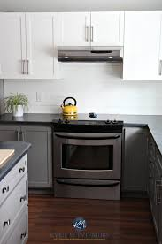 two tone kitchen cabinets with black countertops a budget friendly kitchen update white gray and gorgeous