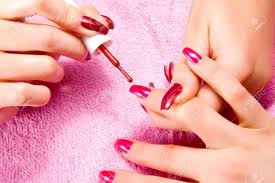 young woman with beautiful long nails make the manicure stock