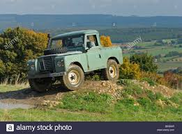 Light Green 1970s Land Rover Series 3 Swb Truck Cab On A Forest