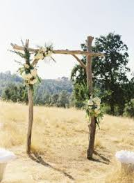 wedding arches made of branches this rustic created altar from a vintage door and two