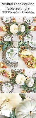 neutral thanksgiving table decor in a farmhouse style with eucalyptus