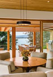 modern tropical dining room tropical with wood round table frosted
