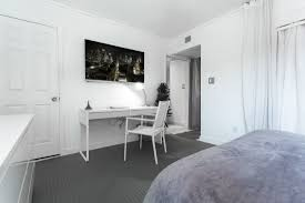 Small Bedroom With Desk Design White Wooden Desk And White Wooden Chair On Grey Carpet Connected