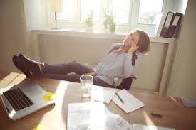 Legs On Desk Young Beautiful Businesswoman At Table Resting With Her Legs On