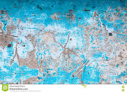 old peeling paint on old blue concrete wall background stock photo