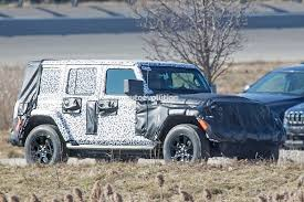 camo jeep grand cherokee 2018 jeep wrangler jl sheds some camo during final testing