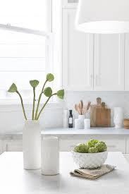 gray shaker kitchen cabinets with white subway tile herringbone
