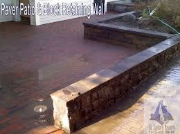Paver Patio With Retaining Wall by Rl Sanborn Masonry A Section Of A A Paver Patio And A Railroad