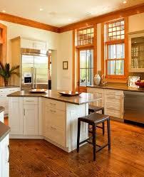 white kitchen cabinets with oak flooring oak floors and trim with white cabinets and grayish counter