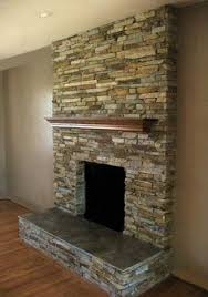 beam and stacked stone fireplace heart house ideas pinterest