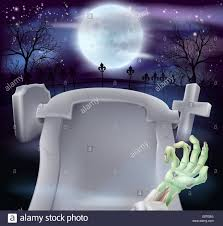 grave halloween background of zombie arm and a gravestone in a