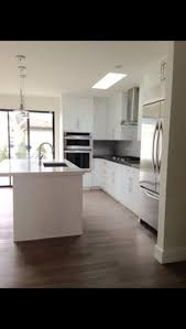 Slab Door Kitchen Cabinets by White Cabinet By Ultracraft Slab Door Artic White In Satin Finish