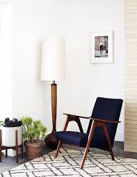 Midcentury Modern Floor Lamp - white mid century modern lamp placed near a graphic rug founterior